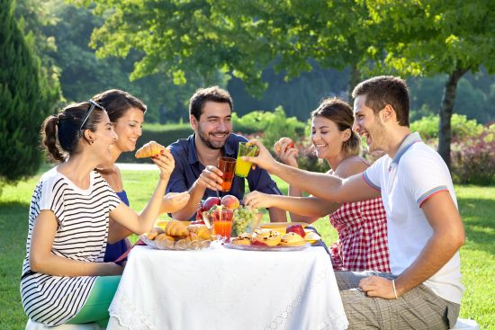 Friends enjoying a relaxing picnic